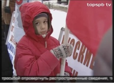Six year old son at picket in favor of law banning Americans from adopting Russian orphans
